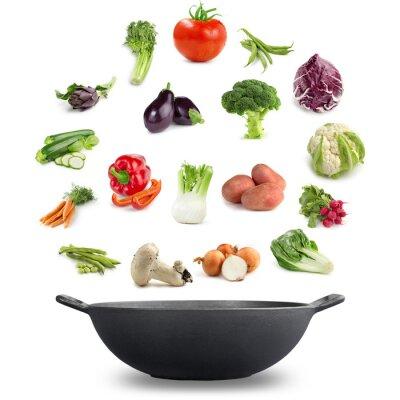 Fototapeta Kuchnia wegańska koncepcja: odmiany warzyw Powyższe żeliwnym naczyniu