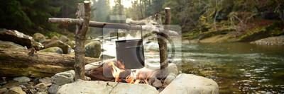 Fototapeta Kulinarny jedzenie w garnku nad ogniskiem plenerowym