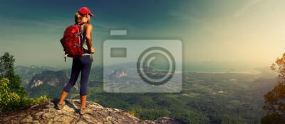 Fototapeta Lady hiker on the mountain