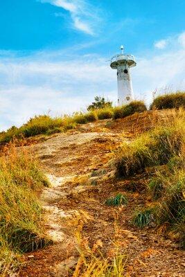Fototapeta Latarnia morska na wzgórzu