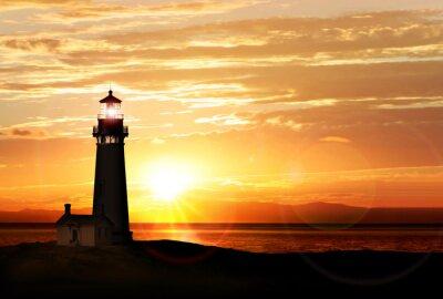 Fototapeta Latarnia morska na zachodzie słońca