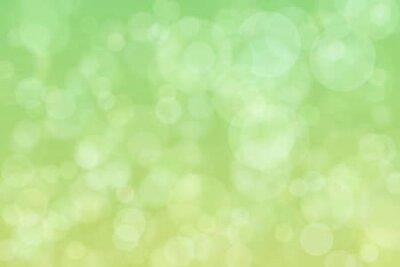 Fototapeta Light spots on green background. Abstract bokeh.