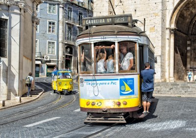 Fototapeta LISBON, PORTUGAL - JULY 28  Traditional yellow  trams downtown Lisbon on July 28, 2013  Trams are used by everyone and also keep the traditional style of the historic center of Lisbon
