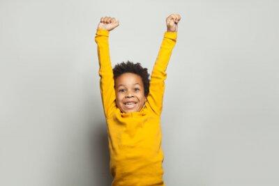 Fototapeta Little black child win-win! Kid boy having fun on white background