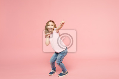 Fototapeta Little cute child kid baby girl 3-4 years old wearing light clothes dancing isolated on pastel pink wall background, children studio portrait. Mother's Day, love family, parenthood childhood concept.