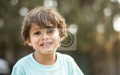 Fototapeta little three years old boy portraits in summer afternoon