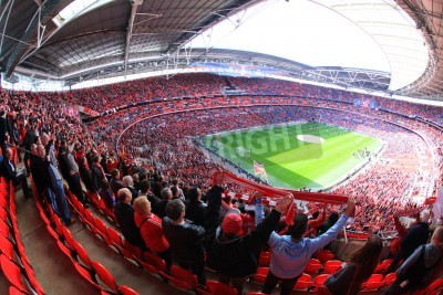 Fototapeta LONDON - APRIL 14 : Supporters watch the football game of Liverpool - Everton Semi Final FA Cup Crowd at Wembley Arena Staduim on April 14, 2012 in London, England United Kingdom.