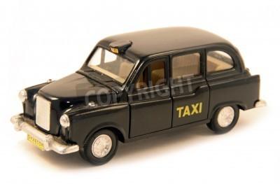 Fototapeta London souvenir, depicting a typical taxi of the city