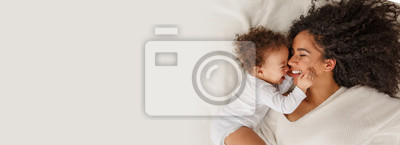 Fototapeta Love of a mother and baby. Family at home. Lifestyle