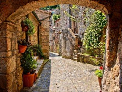 Fototapeta Łukowe brukowanej ulicy w toskańskie wsi, Włochy