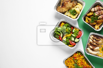 Fototapeta Lunchboxes on color table, flat lay. Healthy food delivery