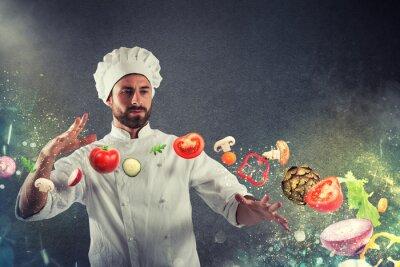 Fototapeta Magiczny szef kuchni przygotowywający gotować nowego naczynie