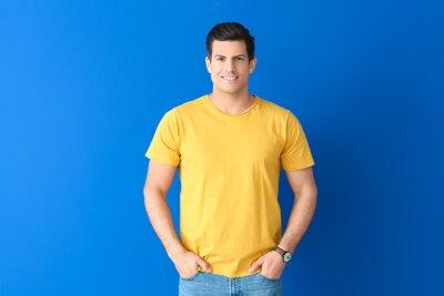 Fototapeta Man in stylish t-shirt on color background