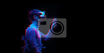 Fototapeta Man is using virtual reality headset. Image with glitch effect.