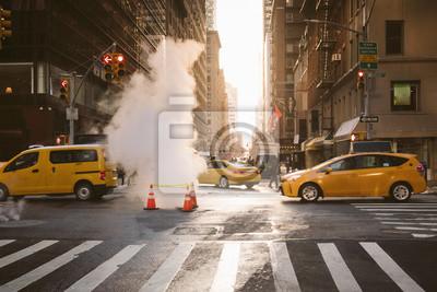 Fototapeta Manhattan ranku wschodu słońca widok z żółtymi taksówkami