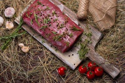 Fototapeta Meat on a cutting board.