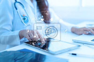 Fototapeta Medicine doctor or medical students with stethoscope using digital tablet laptop,Health Check with digital system support for patient with medical icon at hospital, Medical network technology concept.