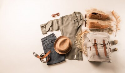 Fototapeta Men's clothing and accessories - tourist or traveler casual outfit