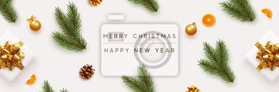 Fototapeta Merry Christmas and Happy New Year banner. Xmas background with realistic festive decorative design elements. Pine and spruce branches, gift box, pine cone, orange, ball bauble. Flat lay, top view.