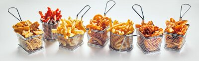 Fototapeta Metal baskets with French fries on white background