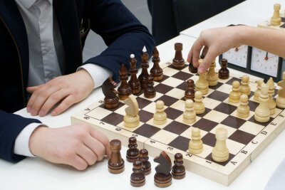Fototapeta Mężczyźni grają w szachy. Biznes i szachy.