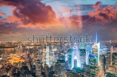 Fototapeta Midtown Manhattan skyscrapers night lights, aerial view of New York City.