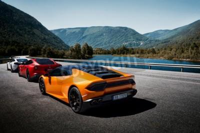 Fototapeta Miland, Norway. 04.06.2016: Yellow Lamborghini Huracan, Red Ferrari f12m and white Mclaren 650s