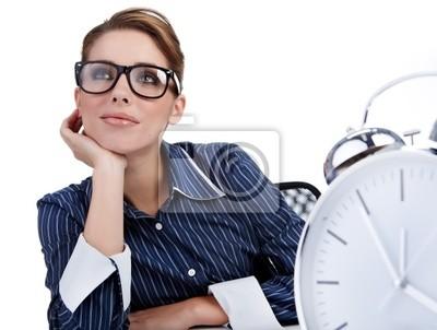 Fototapeta Młoda businesswoman z dużym zegarem