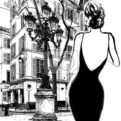 Młoda elegancka kobieta w czarnej sukni