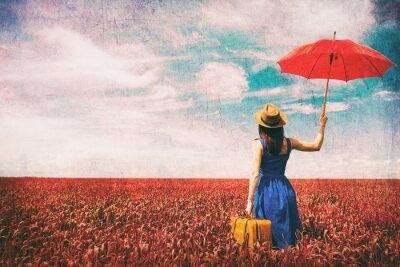 Fototapeta Młoda kobieta z walizką i parasolką