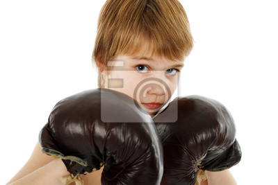 Młody bokser Chłopiec z rękawice bokserskie