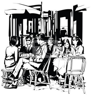 Młodzi ludzie na tarasie kawiarni po pracy