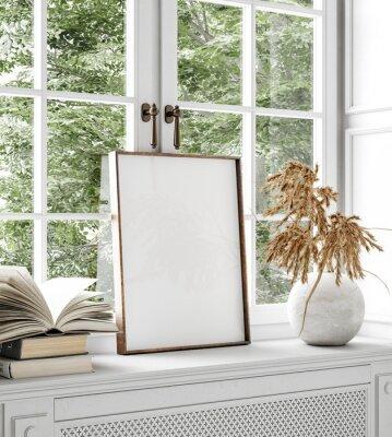 Fototapeta Mockup frame, dry flower and books standing close up near window, 3d render