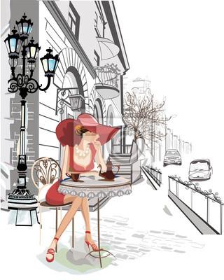 Moda dziewczyna siedzi w kawiarni na starówce