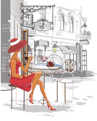 Moda dziewczyna w kawiarni ulicznej.