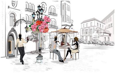 Moda ludzie w kawiarni ulicy. Uliczna kawiarnia z kwiatami w starym mieście. Kelnerzy obsługują stoły.