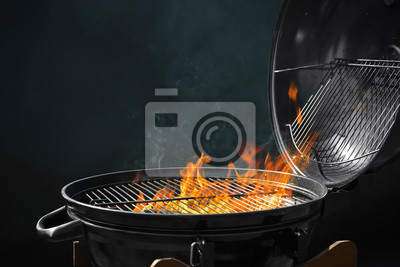 Fototapeta Modern barbecue grill with burning fire on dark background