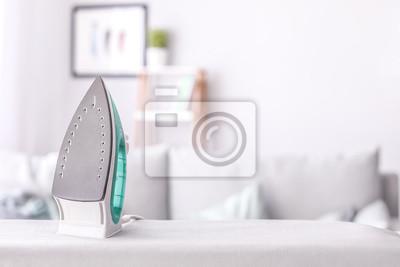 Fototapeta Modern iron on board in room