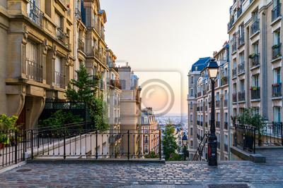 Fototapeta Montmartre district of Paris. Morning Montmartre staircase in Paris, France. Europa. View of cozy street in quarter Montmartre in Paris, France. Architecture and landmarks of Paris. Postcard of Paris.