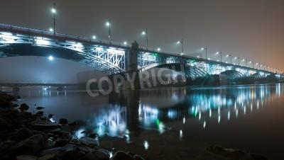 Fototapeta Most oświetlone w nocy we mgle. Most Poniatowskiego