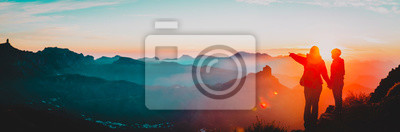 Fototapeta mother and son travel in mountains at sunset, panorama