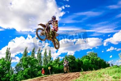 Fototapeta motocross rider on the race