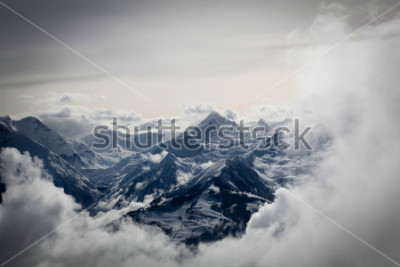 Fototapeta Mountains view through the clouds in Salzburg, Austria.