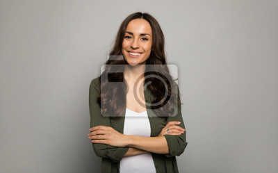 Fototapeta Mrs. Excellence. Close-up photo of adorable woman, posing in white t-shirts and smiling while looking in the camera.