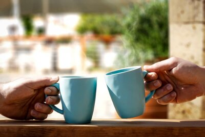 Mug of hot drink and hands.Morning time and free space for your decoration.