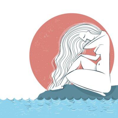 Fototapeta Naga kobieta z długimi włosami siedzi na plaży i patrząc na s