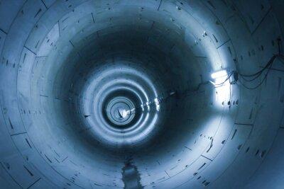 Fototapeta Najdłuższy tunel w podziemiu świeci niebieskim światłem