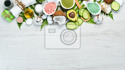 Fototapeta Natural Cosmetics: Avocado, coconut, sea salt and face cream. The concept of cosmetics and spa. Top view. Free copy space.