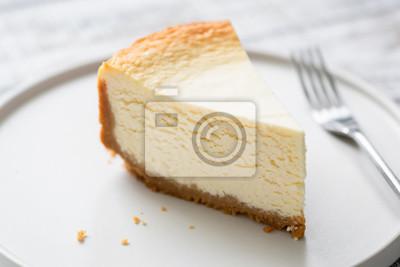 Fototapeta New York Cheesecake Slice On Plate. Closeup view. Tasty smooth cheesecake