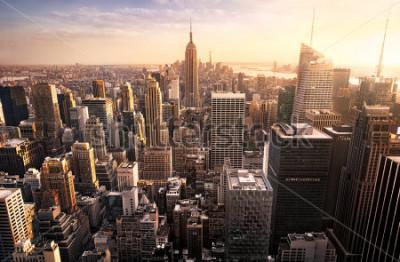 Fototapeta New York City skyline with urban skyscrapers at sunset, USA.